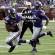Minnesota Vikings running back Adrian Peterson (28) runs  against the Detroit Lions as Vikings quarterback Teddy Bridgewater (5) watches in the first half of an NFL football game in Minneapolis, Sunday, Sept. 20, 2015. (AP Photo/Ann Heisenfelt)