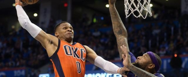 Video: Russell Westbrook puts DeMarcus Cousins' on a poster